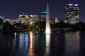 Hermann Park fountain at night with Texas Medical Center as background