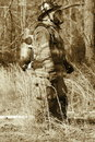 Hero protective gear fireman with sepia Stock Photos