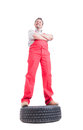 Hero shot of confident mechanic standing on a car wheel isolated white Stock Photography