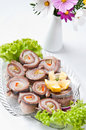 Herring rolls dish elegant food of decorated with lettuce and orange Stock Photography