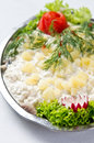 Herring salad dish elegant of fresh fish with cream potatoes lettuce and green decorations Stock Image