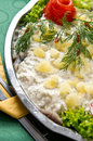 Herring salad dish elegant of fresh fish with cream potatoes lettuce and green decorations Royalty Free Stock Photo
