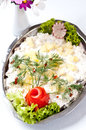 Herring salad dish elegant of fresh fish with cream potatoes lettuce and green decorations Royalty Free Stock Photography