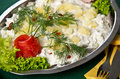 Herring salad dish elegant of fresh fish with cream potatoes lettuce and green decorations Royalty Free Stock Images