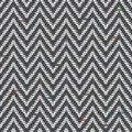 Herringbone Tweed pattern in greys repeats Royalty Free Stock Photo