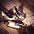 Beside herself a night with joy ladies high heels and alcohol Royalty Free Stock Photo