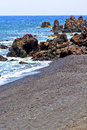 Hervideros brown rock in white coast water summer lanzarote spain beach stone and Royalty Free Stock Photos