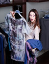 Hesitating about clothes at the store Stock Image