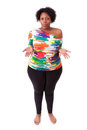 Hesitating young fatty black woman looking up african people isolated on white background Royalty Free Stock Photo