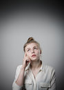Hesitation girl full of doubts and young slim woman Royalty Free Stock Photos