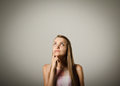 Hesitation girl is full of doubts and young woman is doing something Royalty Free Stock Image