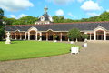 Het loo palace the historic stables in in apeldoorn netherlands Stock Image