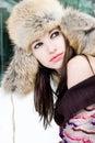 Het portret van de winter van jonge vrouw in bonthoed Stock Afbeelding