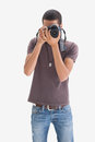image photo : Hip young man pointing his camera at the camera