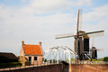 Heusden windmill and drawing bridge in a fortified town in the netherlands Royalty Free Stock Photos