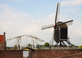 Heusden windmill and drawing bridge in a fortified town in the netherlands Stock Photo