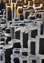 The hexagonal basalt columns of giants causeway antrim coastline northern ireland is most popular tourist Royalty Free Stock Images