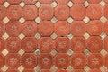 Hexagonal floor tiles old victorian floral pattern showing wear Stock Image