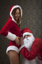 Hey he s kicking santa claus and mrs santa is very excited with their pregnancy Stock Images