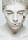 Hibernation and sleep girl with closed eyes and insect on her cheek Stock Photo