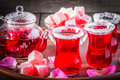 Hibiscus tea in glasses with turkish delight on rustic wooden background. Royalty Free Stock Photo