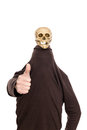 Hidden man with witty skull on his head thumbs up a Stock Photo