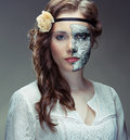 Hiding behind a mask portrait of young woman wearing close up Royalty Free Stock Photo