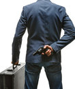 Hiding gun behind his back studio photography of criminal man with pistol and briefcase isolated on white background Stock Image