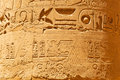 Hieroglyphic on the pillars of karnak temple in luxor egypt Royalty Free Stock Images