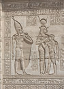 Hieroglypic carvings on an egyptian temple Stock Photos