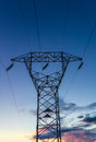 Hig voltage at sunset in tuscany on high pylons Royalty Free Stock Image