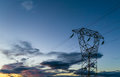 Hig voltage at sunset in tuscany on high pylons Stock Image