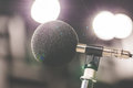 High accuracy microphone in noise sound testing room with LED light bokeh. High technology. Microphone for noise recorder. Royalty Free Stock Photo