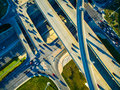 High Aerial Drone view over overpassing interchanges and interstates and highways and roads Royalty Free Stock Photo