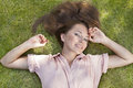 High angle portrait of beautiful young woman lying in grass Royalty Free Stock Photos