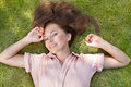High angle portrait of beautiful young woman lying in grass Royalty Free Stock Photo