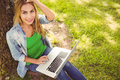 High angle portrait of woman holding laptop with hand in hair Royalty Free Stock Photo