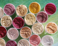 High-angle shot of food coloring powders