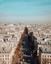 High angle view of The Avenue des Champs-Elysees under sunlight and a blue sky in Paris