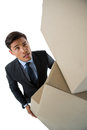 High angle view of businessman carrying cardboard boxes Royalty Free Stock Photo