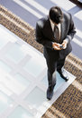 High angle view of businessman with cell phone