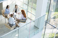 High angle view of businesswomen discussing at table in office Royalty Free Stock Photo