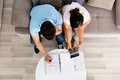 High Angle View Of Couple Calculating Budget Royalty Free Stock Photo