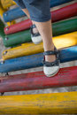 High angle view of girl walking on jungle gym Royalty Free Stock Photo