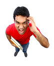 High angle view of  an Indian student going crazy. Royalty Free Stock Photo