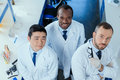High angle view of multiracial group of scientists standing together Royalty Free Stock Photo