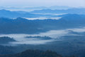High angle view over tropical mountains with white fog in early morning Royalty Free Stock Photo