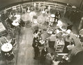 High angle view of people at cocktail lounge aboard ship
