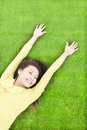 High angle view of pretty woman relaxing and lying on grass Royalty Free Stock Photo