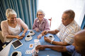 High angle view of senior friends playing cards Royalty Free Stock Photo